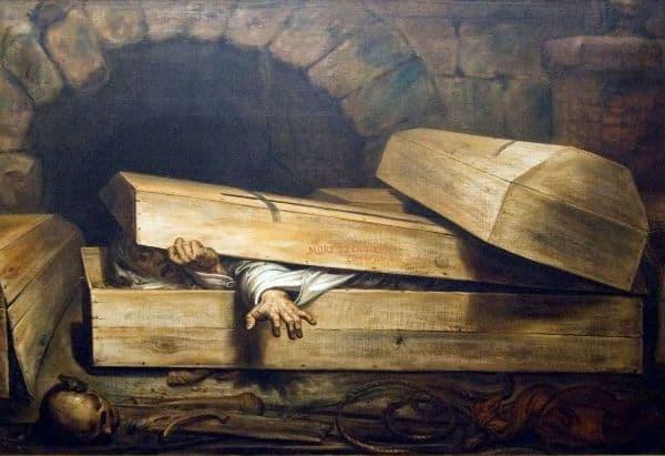 В гробу