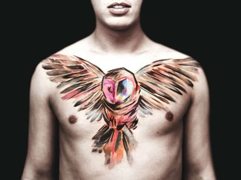 татуировка совы у парня